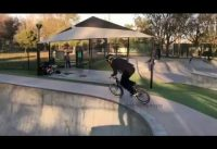 BMX Biker narrowly avoids being impaled on a fence