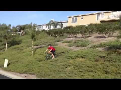 Kid eats pavement on mountain bike
