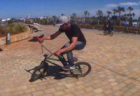 Riding BMX freestyle on street