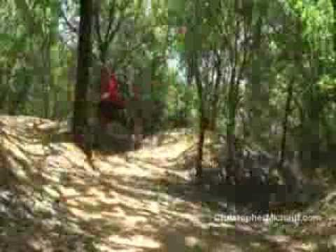 Christopher Michaut riding a mountain bike at Leon Creek in San Antonio