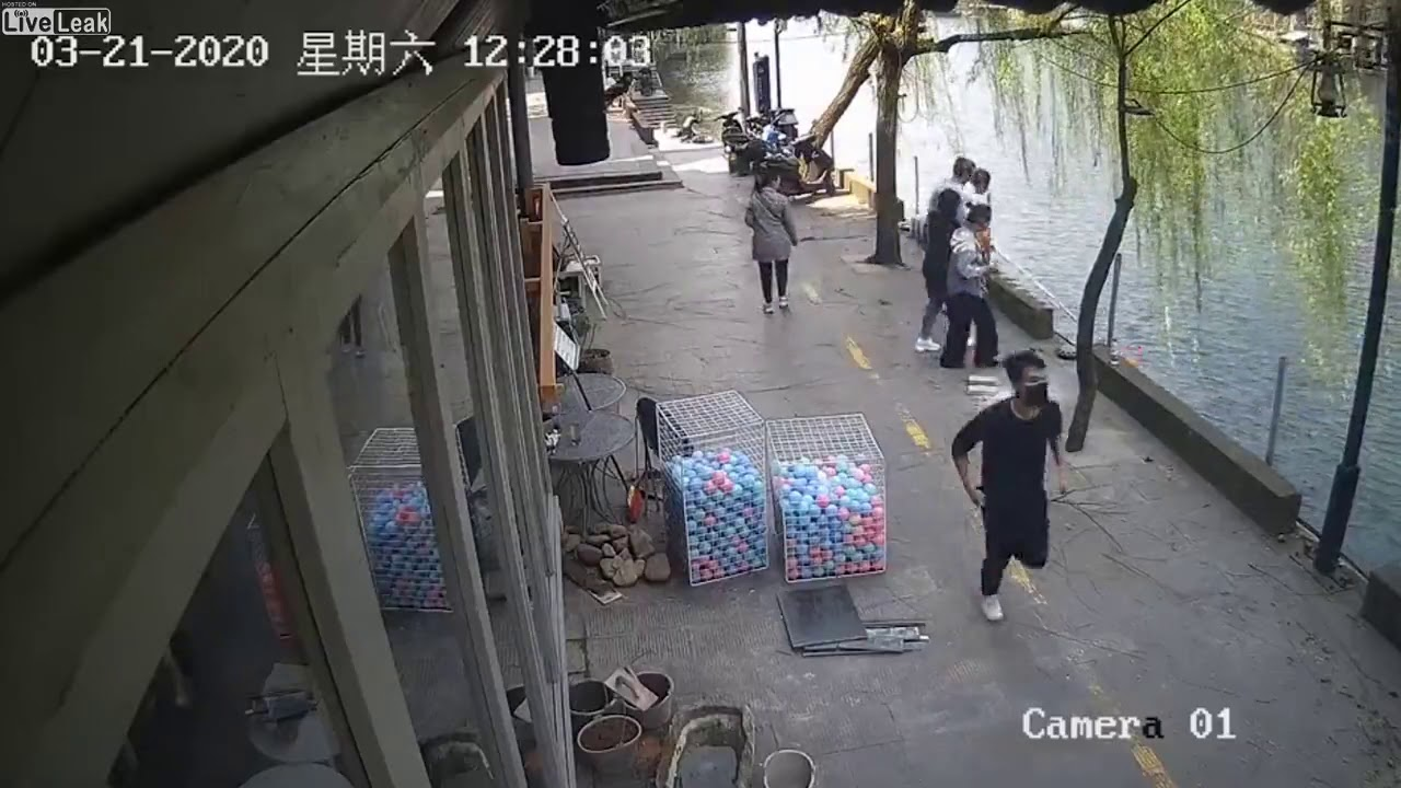 Liveleak com   Pub Owner Saves Boy After Bike Crashes Into River