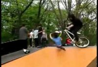 BMX Rider Takes Out Rollerblader