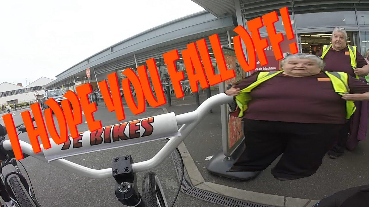 CRAZY WOMAN DOESN'T LIKE WHEELIE BIKES! learning to wheelie my SE bike.