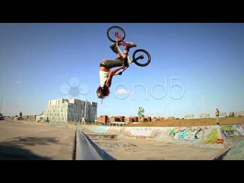 Pond5 Stock Footage - Bmx Bicycle Back Flip Slow Motion In Graffiti Covered Skateboard Park